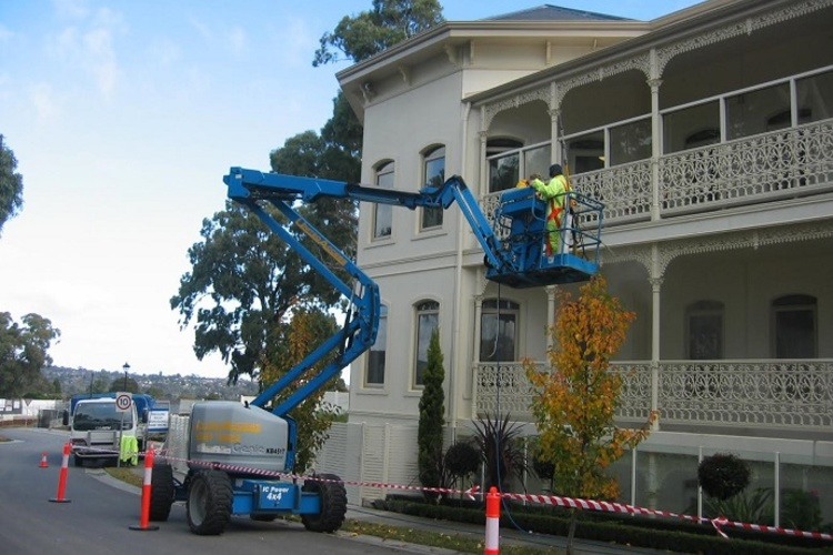 building_cleaning_using_cherry_picker.jpg