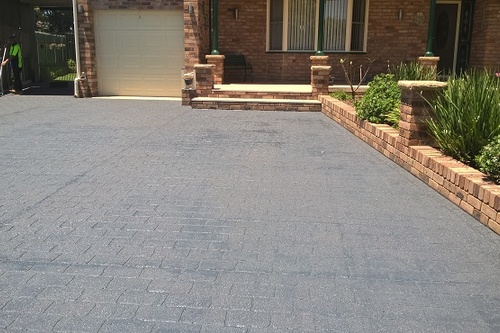 https://luminousau.s3.amazonaws.com/uploads/website_image/category_element/1597/preview_Worn_Stencilcrete_Driveway_Painting.jpg