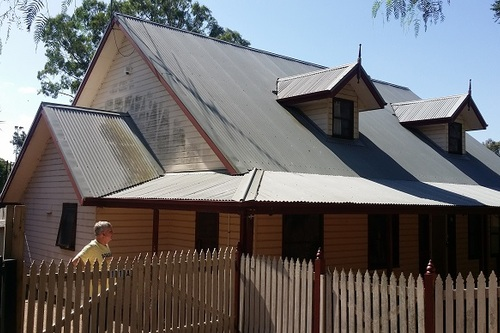 Mould on house cladding and roof