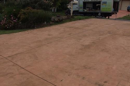 Coloured concrete driveway fading