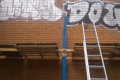 Graffiti_attack_at_business_property.jpg