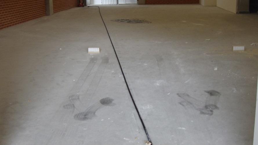 Factory_floor_before_clean_and_seal.jpg