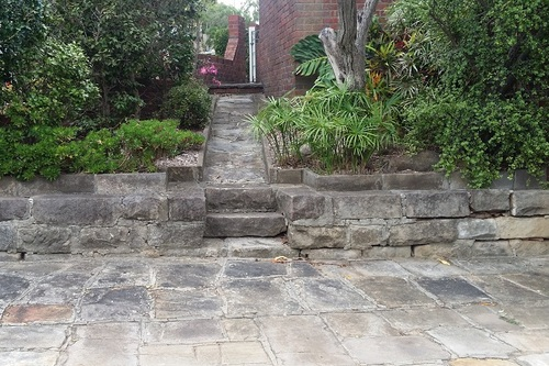 Old_sandstone_pathway_before_cleaning.jpg