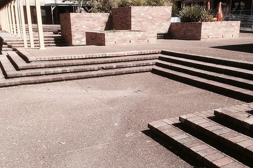 School concrete paths and stairs with mould and dirt