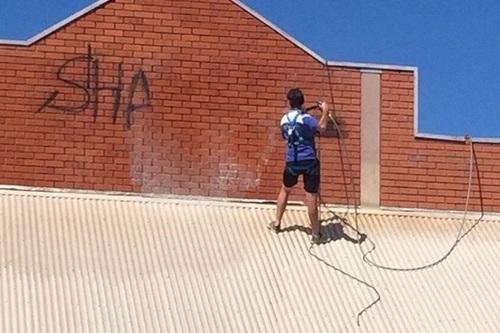 Shop front graffiti removal